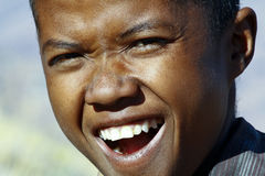 Portrait of adorable young happy boy - african poor child Royalty Free Stock Image