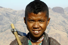 Portrait of adorable young happy boy - african poor child Royalty Free Stock Images