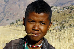 Portrait of adorable young happy boy - african poor child Stock Photos
