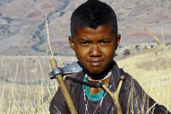 Portrait of adorable young happy boy - african poor child Stock Image