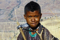 Portrait of adorable young happy boy - african poor child Stock Images
