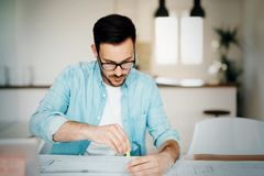 Portrait of adult architect working on plans and blueprints Royalty Free Stock Image