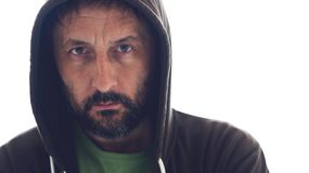 Portrait of adult bearded male wearing hoodie royalty free stock photo