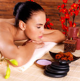 Portrait of an adult beautiful woman relaxing in spa salon Royalty Free Stock Images