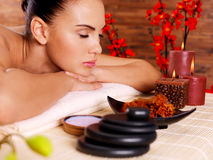 Portrait of an adult beautiful woman relaxing in spa salon Stock Image