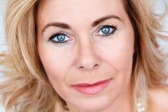 Portrait of adult blond woman. Horizontal portrait of adult blond woman with makeup Stock Image