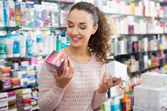 Portrait of adult brunette selecting skincare Royalty Free Stock Photos