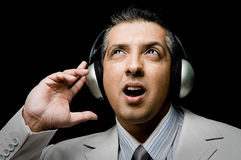 Portrait of adult businessman listening music Stock Image