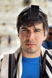 Jewish Tourist Portrait at the Western Wall. Portrait of an adult Caucasian Jewish man on the blurred background of the Western Wall in Jerusalem, the holiest Stock Image