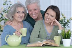 Portrait of adult daughter with senior parents royalty free stock image
