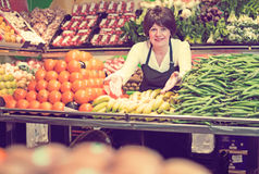 Portrait of adult female selling fruits and vegetables Stock Photography