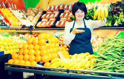 Portrait of adult female selling fruits and vegetables Stock Images
