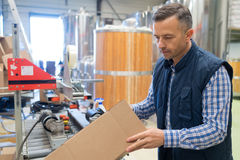 Portrait adult glad male brewery worker. Portrait of adult glad male brewery worker Stock Photography