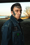 Portrait of adult Guy with tattooed Face in denim Jacket Stock Images