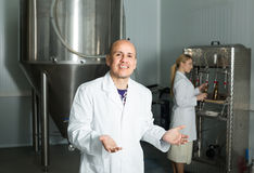 Portrait of adult happy male brewery worker. On beer production factory Stock Photography