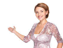 Portrait of adult happy woman with presentation gesture. Portrait of a beautiful adult happy woman with presentation gesture over white background Stock Photo