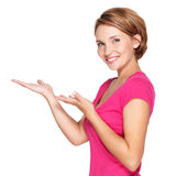 Portrait of adult happy woman with presentation gesture Royalty Free Stock Photo