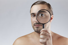 Portrait of a adult man with a magnifying glass Stock Photography
