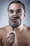 Portrait of a adult man with a magnifying glass Royalty Free Stock Photography