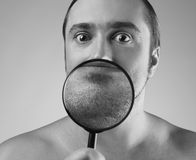 Portrait of a adult man with a magnifying glass Royalty Free Stock Photo