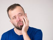Man having tooth pain. Portrait of adult man suffering from tooth pain ache. Dental problem, health issues concept stock photography