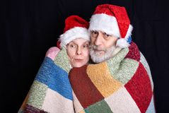 Adult man with white beard and woman disguised in Santa Claus royalty free stock images
