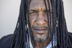 Portrait of adult strong black men with long dreadlocks and blue eyes. Stock Photo