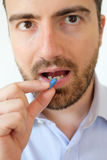 Portrait adult taking a pill royalty free stock image
