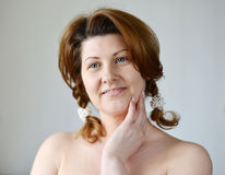 Portrait of an adult woman with bare shoulders Stock Image