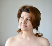 Portrait of an adult woman with bare shoulders Stock Photos