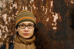 Portrait of adult woman in a cap and glasses Royalty Free Stock Photo