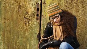 Portrait of adult woman in a cap and glasses Royalty Free Stock Images