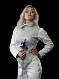 Portrait of adult woman fencer. Holding rapier. Olympic sports, martial arts and professional training concept Stock Photo