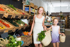 Portrait of adult woman and girl shopping Stock Photo