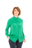 Portrait of adult woman in green blouse looking up Royalty Free Stock Images