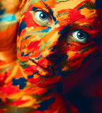 Portrait of adult woman with paint strokes on face stock photo