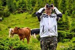 Portrait of adventure man with binoculars Royalty Free Stock Photo