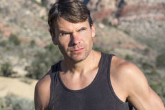 Portrait of adventurous outdoorsman in the desert Royalty Free Stock Photography