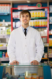 Portrait of affable male pharmacists. Working in modern farmacy Royalty Free Stock Photos