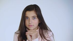 Portrait of afraid and shocked young girl looking on background. Portrait of afraid and shocked young girl on background. Full HD stock video footage