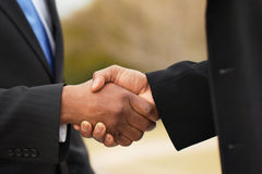 Portrait of African American businessmen making a deal stock image