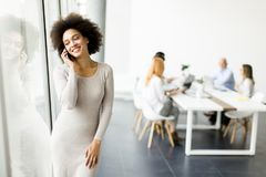 Young African American businesswoman using mobile phone. Portrait of African American businesswoman using mobile phone royalty free stock images