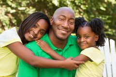 African American father and his children. Portrait of an African American father and his children Royalty Free Stock Images