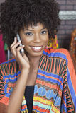 Portrait of an African American female fashion designer on phone call Royalty Free Stock Images