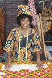 Portrait of an African American female fashion designer with sewing pattern and cloth Stock Photography