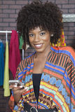 Portrait of an African American female fashion designer using cell phone Royalty Free Stock Image
