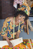 Portrait of an African American female fashion designer working on fabric Royalty Free Stock Photo
