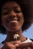 Portrait of African American girl with a flower in her hand Stock Images