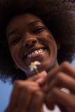 Portrait of African American girl with a flower in her hand Stock Image