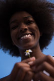 Portrait of African American girl with a flower in her hand Royalty Free Stock Images